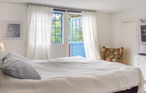 Säng eller sängar i ett rum på Ljunghusen