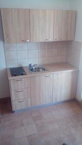 Kuhinja oz. manjša kuhinja v nastanitvi Apartments Hostin Garoful Duga Uvala