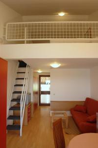 Predel za sedenje v nastanitvi Apartments Hostin Garoful Duga Uvala
