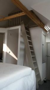 A bed or beds in a room at Beach hut seaside cottage