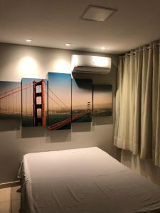 A bed or beds in a room at Apartamento na Praia de João Pessoa