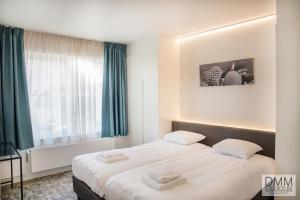 Een bed of bedden in een kamer bij Novo panoramic sea view