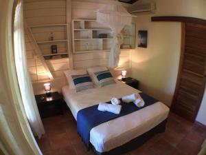 Un ou plusieurs lits dans un hébergement de l'établissement Villa des Amandiers