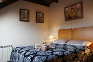 A bed or beds in a room at Aconchegante apto Natal Luz