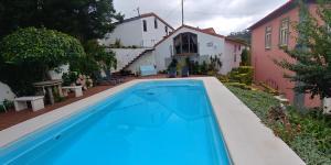 The swimming pool at or near Quinta das Águias