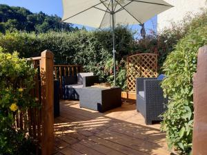 A patio or other outdoor area at dog friendly nancecliff cottages