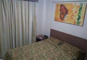 A bed or beds in a room at Veredas do Rio Quente