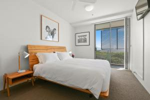 A bed or beds in a room at Cairns Private Apartments