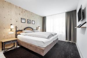 Een bed of bedden in een kamer bij Apart am Sonnenhügel