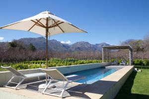 The swimming pool at or near La Chataigne Wines & Guest Cottages