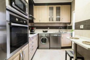 A kitchen or kitchenette at Home & Private Terrace WIFI + AIRCON