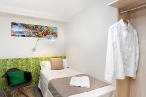 Säng eller sängar i ett rum på Mercedes Heritage Apartments