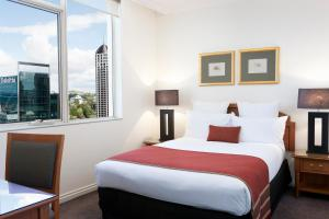 A bed or beds in a room at The Sebel Quay West Auckland