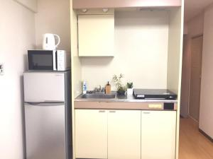 A kitchen or kitchenette at F Mansion / Vacation STAY 977