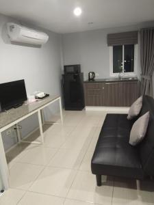 Гостиная зона в Asia's Beach Apartments