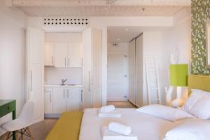 A bed or beds in a room at Salvator Villas & Spa Hotel