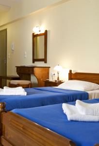 A bed or beds in a room at Evangelia