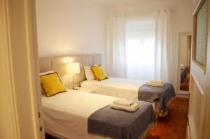 A bed or beds in a room at Furnas20 Lisbon Flats