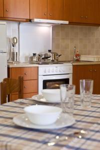 A kitchen or kitchenette at Evangelia