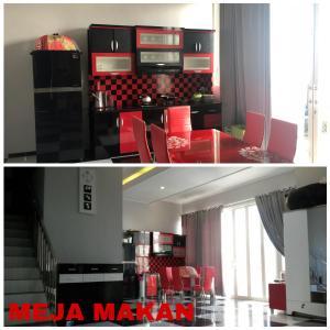 A restaurant or other place to eat at villa di batu kamar tidur 5