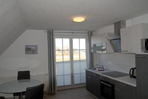 A kitchen or kitchenette at Boddenhus Apartment 9