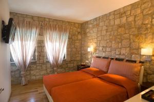 מיטה או מיטות בחדר ב-Blue Dream Luxury Villas