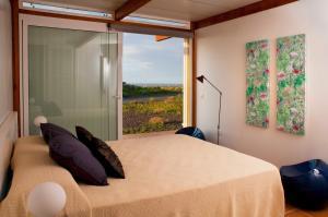 En eller flere senger på et rom på Casas Bioclimáticas Iter