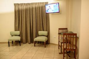 A seating area at AVEMAR Apart Hotel