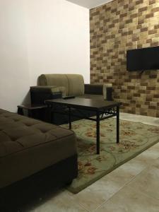 Predel za sedenje v nastanitvi Noor Hotel Apartments