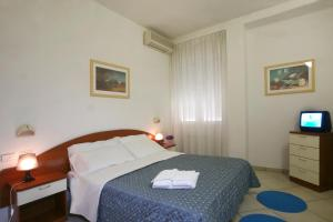 A bed or beds in a room at Residence I Girasoli