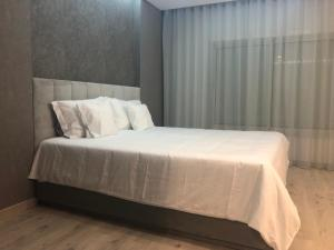 A bed or beds in a room at LOVELY FÁTIMA