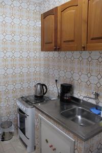 A kitchen or kitchenette at Apart no Menino Deus