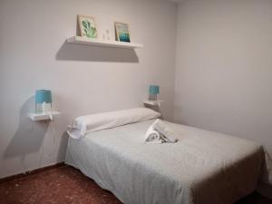 Cama o camas de una habitación en Apartamentos Gav