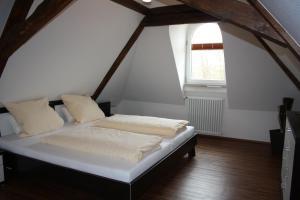Ein Bett oder Betten in einem Zimmer der Unterkunft Thai Tawan