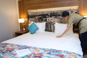 A bed or beds in a room at Melliber Appart Hotel
