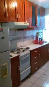 Una cocina o zona de cocina en Departamento Amoblado