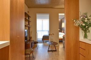 A seating area at My Story Apartments Santa Catarina