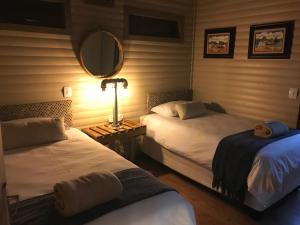 Cama o camas de una habitación en Timmerstuga