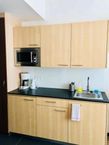 A kitchen or kitchenette at Aparthotel Bianca