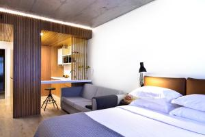 A bed or beds in a room at My Story Apartments Santa Catarina