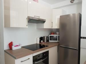Η κουζίνα ή μικρή κουζίνα στο Venus - Marina Baie des Anges