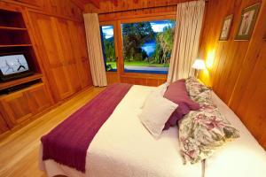 Una cama o camas en una habitación de Casas Costa Lolog Huelcan