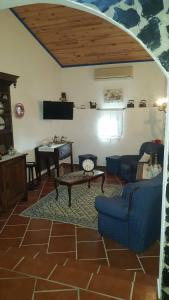 Uma área de estar em Casa do Montinho