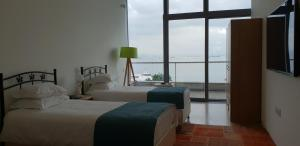 A bed or beds in a room at Ataköy Marina Park Hotel Residence