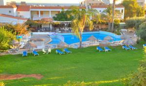 The swimming pool at or near Captain Karas Holidays Apartments