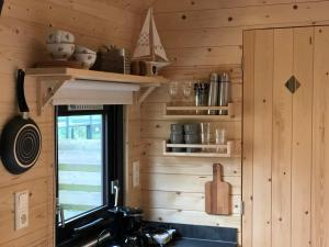 A kitchen or kitchenette at Little Lighthouse Texel