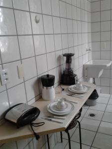 A kitchen or kitchenette at Apart Quartier Latin Hotel