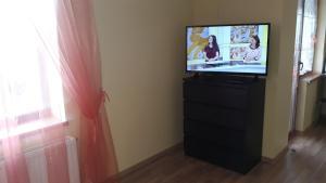 TV tai viihdekeskus majoituspaikassa Sauliaus apartamentai