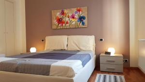 A bed or beds in a room at Il Corso