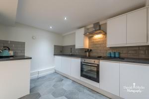 Küche/Küchenzeile in der Unterkunft Union Bank Apartments